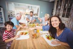 Happy family having breakfast at home. Family having breakfast in kitchen at home Stock Image