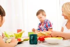 Happy family having breakfast at home Royalty Free Stock Photography