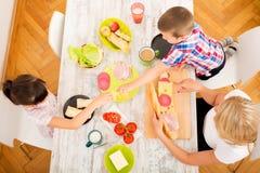 Happy family having breakfast at home Royalty Free Stock Photos