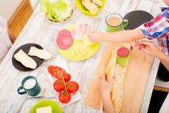 Happy family having breakfast at home Royalty Free Stock Photo