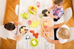 Happy family having breakfast at home Stock Image