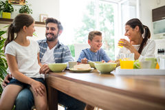 Happy family having breakfast Royalty Free Stock Photos