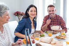 Happy family having breakfast Stock Photography