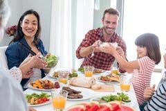 Happy family having breakfast Royalty Free Stock Photo