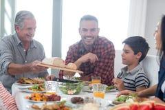 Happy family having breakfast Stock Images