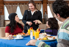 Happy family having breakfast at a restaurant Royalty Free Stock Photos