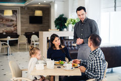 Happy family having breakfast at a restaurant Royalty Free Stock Image
