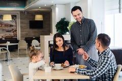 Happy family having breakfast at a restaurant Royalty Free Stock Photo