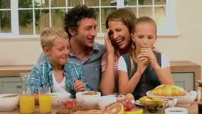 Happy family having breakfast stock video