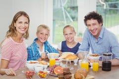 Happy family having breakfast at table Royalty Free Stock Photo