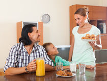 Happy family having breakfast Royalty Free Stock Image