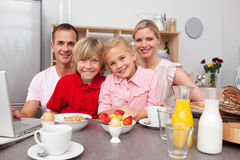 Happy family having breakfast together Stock Image