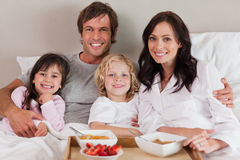 Happy family having breakfast together Stock Photo