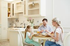 Happy family having breakfast together royalty free stock photography