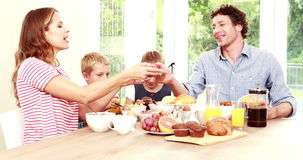 Happy family having breakfast together stock video footage
