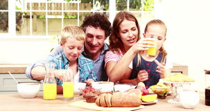 Happy family having breakfast together. At home stock footage