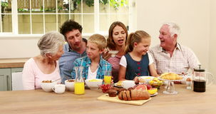 Happy family having breakfast together stock video