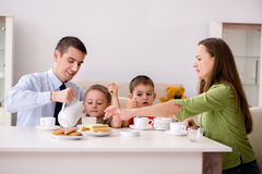 The happy family having breakfast together at home. Happy family having breakfast together at home royalty free stock images