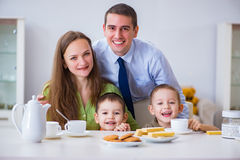 The happy family having breakfast together at home. Happy family having breakfast together at home royalty free stock photos