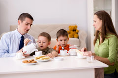 The happy family having breakfast together at home. Happy family having breakfast together at home royalty free stock photography