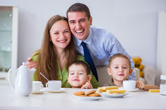 The happy family having breakfast together at home. Happy family having breakfast together at home royalty free stock photo