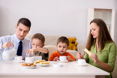 The happy family having breakfast together at home. Happy family having breakfast together at home stock photos