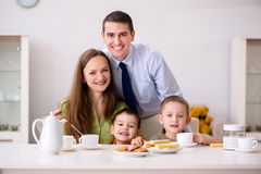 The happy family having breakfast together at home. Happy family having breakfast together at home royalty free stock image