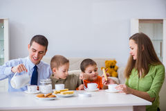 The happy family having breakfast together at home. Happy family having breakfast together at home stock images