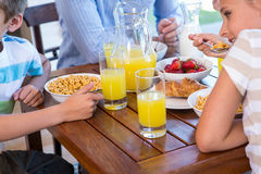 Happy family having breakfast together Stock Photos