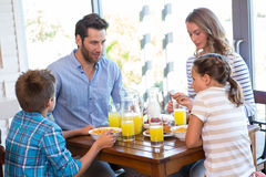 Happy family having breakfast together Stock Photo