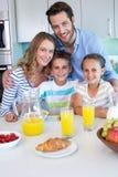 Happy family having breakfast together Stock Photos
