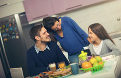 Happy family having breakfast together Royalty Free Stock Images