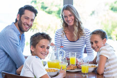 Happy family having breakfast together Stock Photography