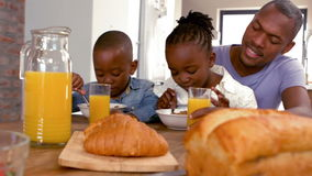 Happy family having breakfast together in the morning stock footage