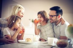 Happy family having breakfast. stock photography