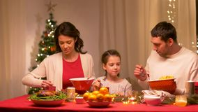 Happy family having christmas dinner at home stock video footage
