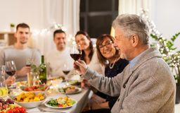 Happy family having dinner party at home stock photos