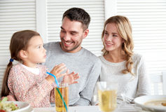 Happy family having dinner at restaurant or cafe Royalty Free Stock Photography