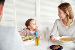 Happy family having dinner at restaurant or cafe Royalty Free Stock Photo