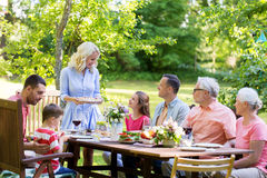 Happy family having dinner or summer garden party Royalty Free Stock Images