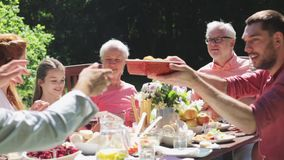Happy family having dinner or summer garden party stock video footage