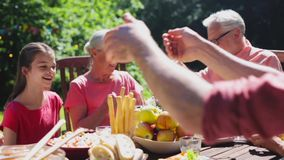 Happy family having dinner or summer garden party stock footage