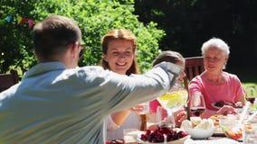 Happy family having dinner or summer garden party stock video