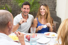 Happy family having food Royalty Free Stock Photography