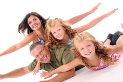 Happy family having fun. Happy family lying down on the floor and having fun Stock Photography