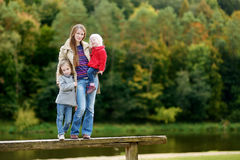 Happy family having fun on autumn day Stock Image
