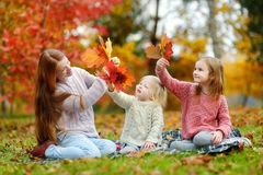 Happy family having fun on autumn day Stock Images