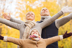 Happy family having fun in autumn park Royalty Free Stock Photo