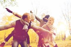 Happy family having fun in autumn park Royalty Free Stock Photos