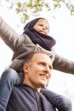 Happy family having fun in autumn park Royalty Free Stock Photography